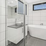 bathroom elegant simplicity adds value in twin units of site redevelopment